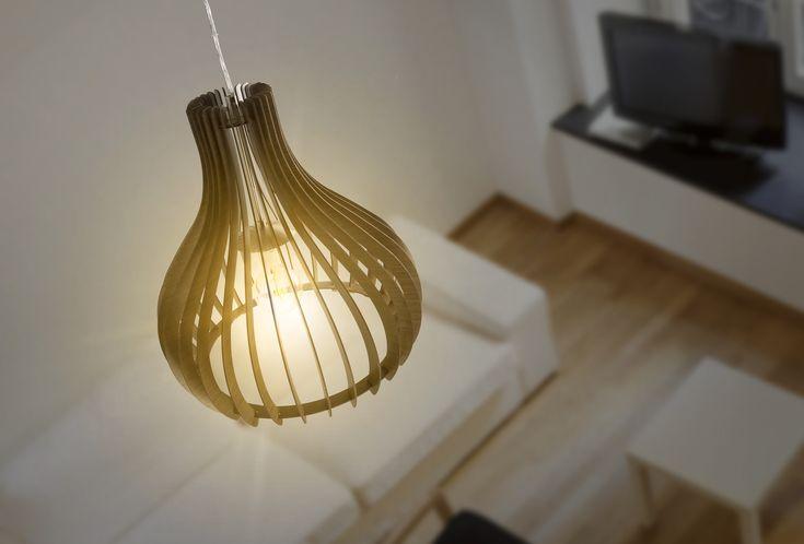 El modelo colgante Tindori y sus texturas de madera se verán muy bien en la sala de tu hogar.