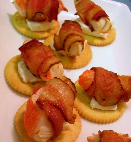 Crabettes!  Don't you love the name?  Bacon-wrapped crab (or imitation crab meat), baked/broiled/grilled, sitting on cream cheese which is sitting on a Ritz.  Yum!