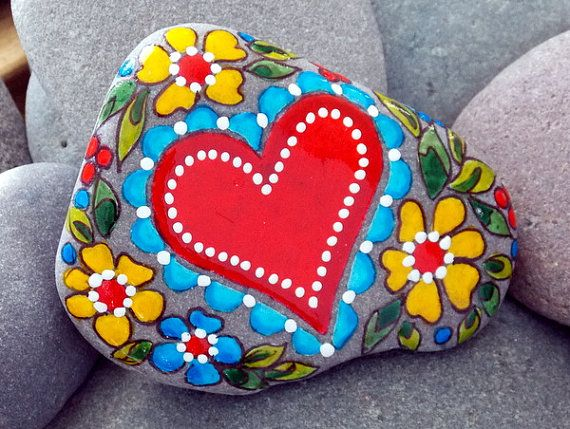 Life is Beautiful. Life is Good. Love is the Answer. Hearts and Flowers. Painted Rock from a Cape Cod beach. Layers of water-resistant glaze inks over paint. Colors of layered water-resistant glaze inks over paint, in shades of cherry and barn red, turquoise and cerulean blue,