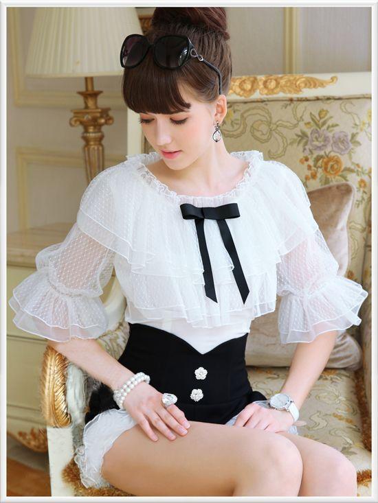 Morpheus Boutique  - White Layer Ruffle 3/4 Flare Sleeve Celebrity Shirt, $89.99 (http://www.morpheusboutique.com/white-layer-ruffle-3-4-flare-sleeve-celebrity-shirt/)