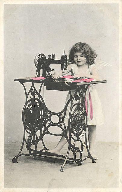 little girl sewing