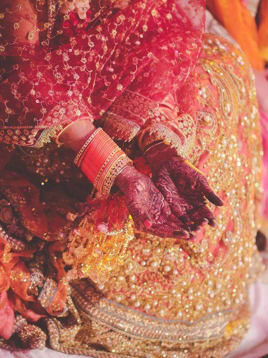 Wedding Ideas - Coral colored chooras. So unique | WedMeGood #wedmegood #ideas