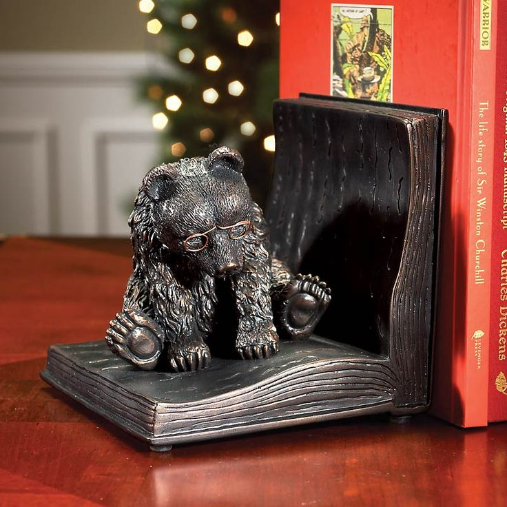 "Reading Bear on a Book Bookend ""He's a studious little bookend that brings charm to your li-beary."" www.levenger.com"