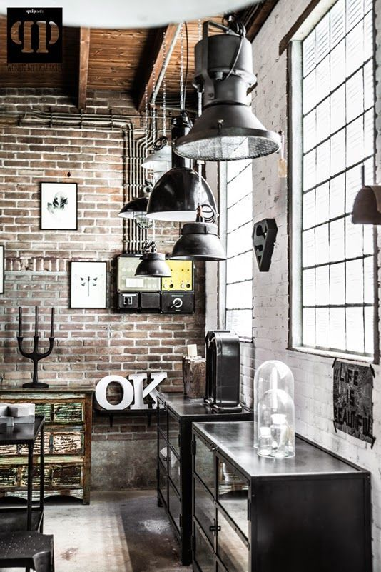 Exposed bricks and wires, retro lighting fixtures, and metal cabinets - industrial interior design