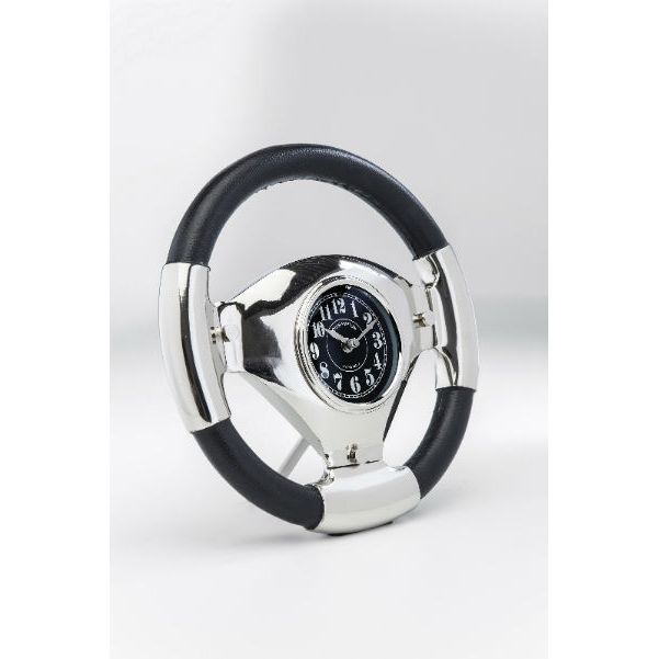 """Ρολόι Steering Wheel 31 Ένα ιδιαίτερο ρολόι, μία έξυπνη πρόταση για όσους είναι λάτρεις της λωρίδας ταχείας κυκλοφορίας, για εκείνους που δεν μπορούν να πάρουν τα μάτια τους από το ταχύμετρο και αυτούς που είναι fun των αγώνων αυτοκινήτων. Απλά τοποθετήστε αυτό το """"Τιμόνι"""" στο χώρο σας και αφήστε την φαντασίας να σας οδηγεί γεμάτη ενέργεια και πάθος. Υπέροχη σχεδίαση με εντυπωσιακές λεπτομέρειες και υψηλής ποιότητας υλικά. Υλικό: Δέρμα, αλουμίνιο, ανοξείδωτο χάλυβα, γυαλί."""