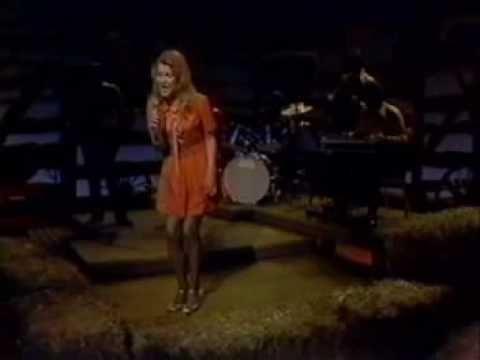 Tanya Tucker - Delta Dawn. The damn girl's 13 with her 1972 hit: Delta Dawn. Amazing...