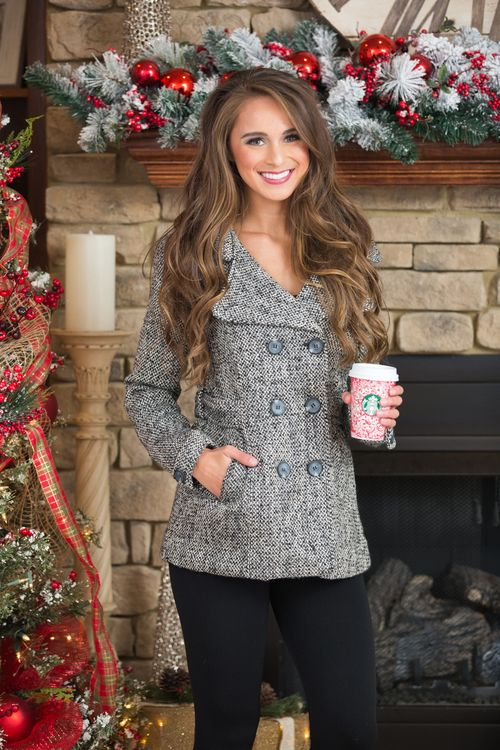 We are in love with this stunning coat! Featuring a wonderfully soft and thick material in a black, white, and grey knit, it's such a knockout look for winter!It also features a classic double-breast