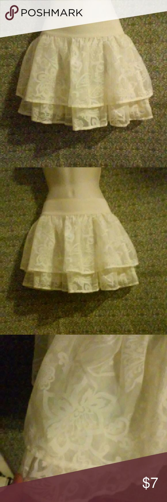 """LACE MINI!! Cute off white colored mini skirt. 2 1/4"""" elastic waist band. Two thin layers of lace and off white underlay. Perfect summer skirt!  Waist is 23"""" around unstretched. Length is 13.5"""" no stains. Small fray as pictured. Aeropostale Skirts Mini"""