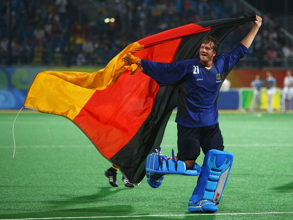 Goalkeeper Max Weinhold of Germany celebrates with his country's flag after winning the Men's Gold Medal Match between Germany and Spain held at the Olympic Green Hockey Field on Day 15 of the Beijing 2008 Olympic Games