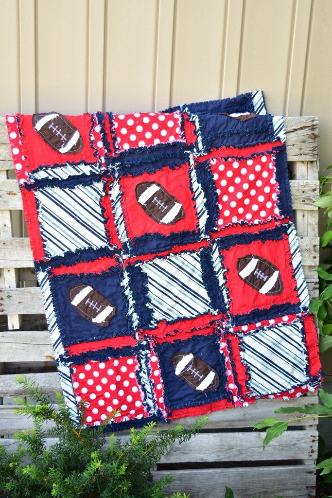 Football Crib Bedding for baby boy nursery. Features navy blue and red fabrics with appliqued footballs. Care: Bumpers: wipe clean Quilt, Pillow sham, Sheet, Cr