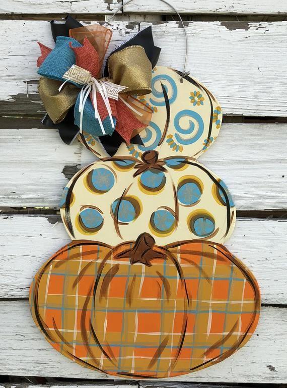 Whimsical personalized pumpkin door hanger