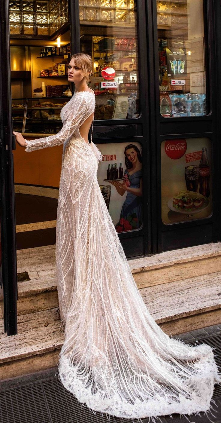 Embroidery which scatters glimmering beads and paillettes over the delicate fabric Long sleeves key hole back Elegant full beaded embellishment Fit and Flare Wedding Dress swept train ,mermaid wedding gown #wedding #weddings #weddingdresses #weddingdress