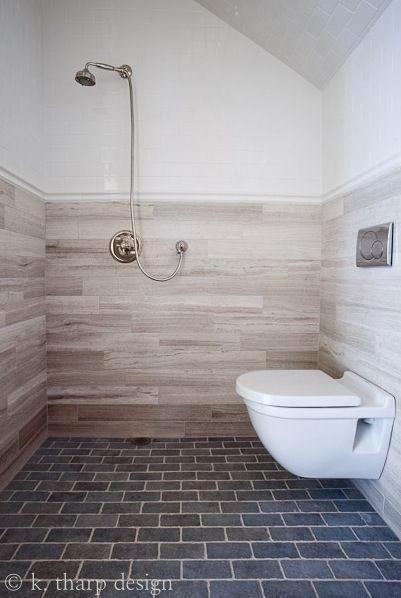 european bath by lisa k. tharp - wall mount toilet, limestone plank tile, open shower wet room