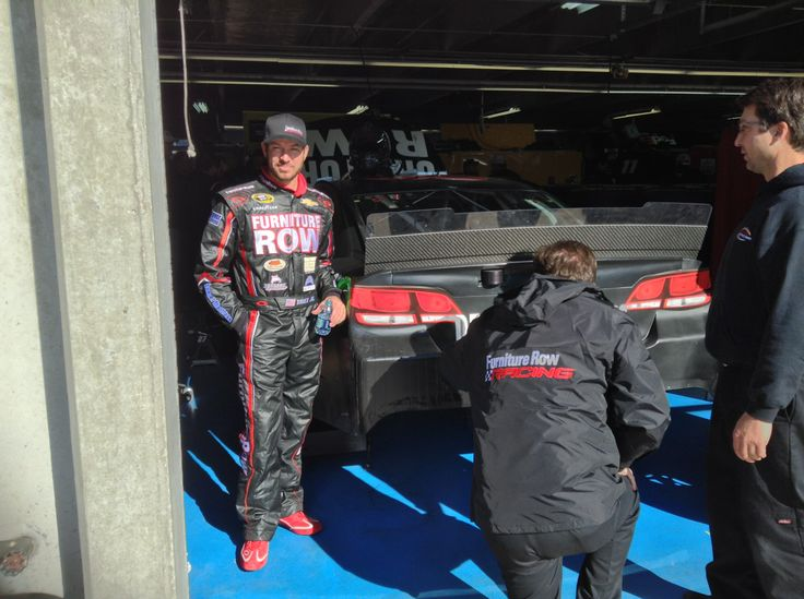 Martin Truex Jr. poses next to the Furniture Row Racing #78 in Charlotte between testing sessions. #NASCAR @Charlotte Motor Speedway @NASCAR