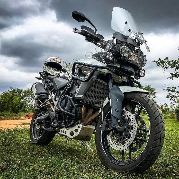 Grass. Dramatic Clouds. Handsome Bike. Makes for an awesome bike pic. Waiting for the weekend... . . . . . #advrider #ride #bikersofindia #triumph #triumphtiger #Triumph #adventure #Bangalore #fortheride #cloudy #motorcycle #weekend #Karnataka #India