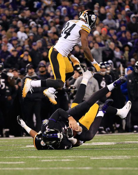 Ike Taylor Photos - Cornerback Ike Taylor #24 of the Pittsburgh Steelers jumps over quarterback Joe Flacco #5 of the Baltimore Ravens during the first half at M&T Bank Stadium on November 28, 2013 in Baltimore, Maryland. - Pittsburgh Steelers v Baltimore Ravens