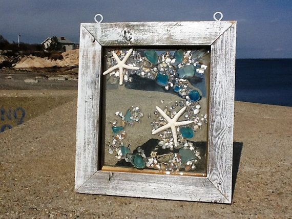 """11"""" wide X 12"""" Two star fish riding a wave of teal, sea foam and frosted beach glass. The materials are not glued but fused into the glass through"""