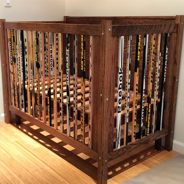 A crib i built out of hockey sticks and oak...                                                                                                                                                                                 More