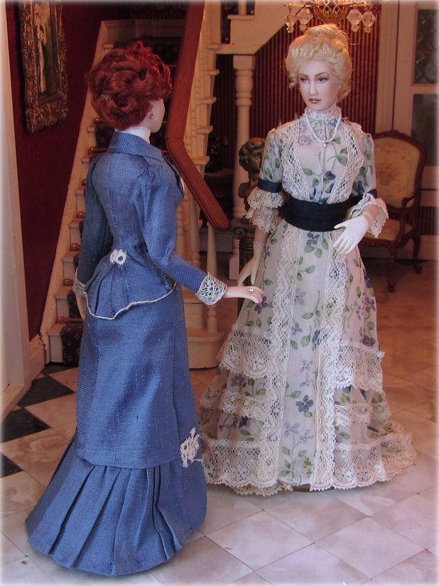 Trish and Jen, dressed in 1898 Spring costume. Porcelain miniature dolls by Annemarie Kwikkel.