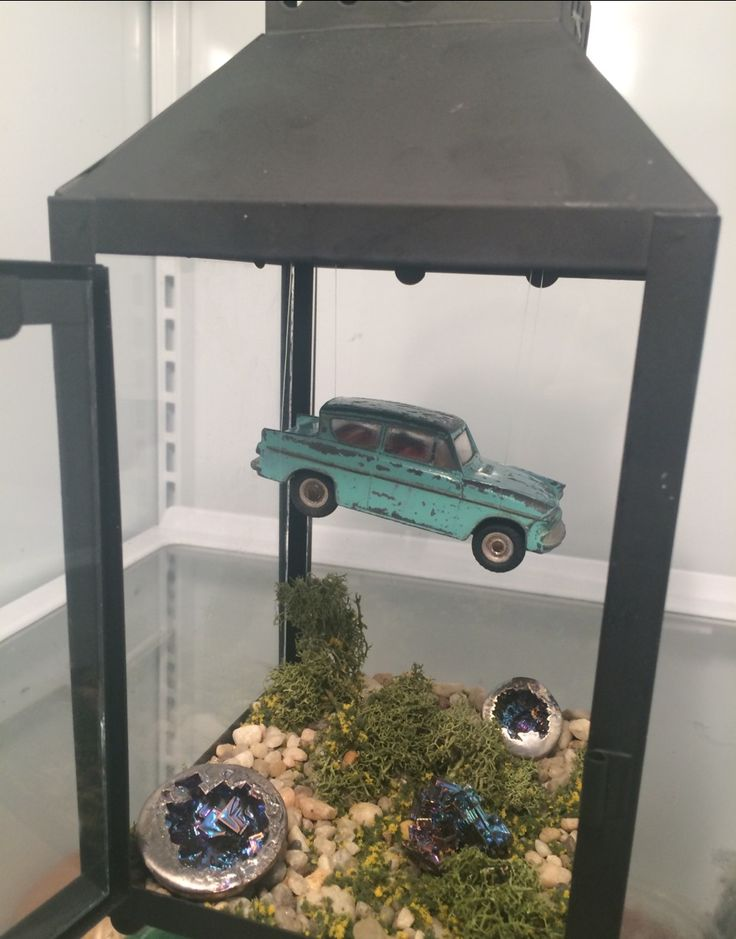 My dad made me this tiny scene of the flying car from Harry Potter and the Chamber of Secrets with a toy version of a Ford Anglia and these gorgeous bismuth stones in a lantern. This may be the...