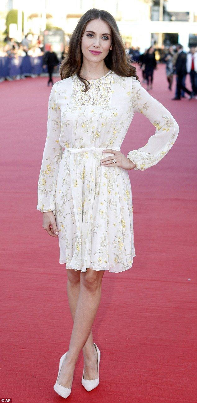 Beautiful: Newly engaged Alison Brie, 32, stunned in a floral dress at the premiere for Sl...