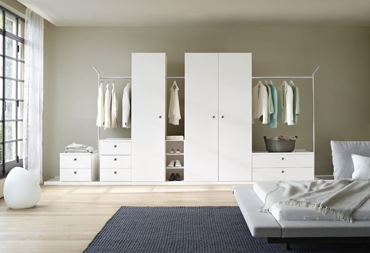 Tarmac storage system.  Versatile and well priced storage in white lacquer with beige linoleum detail Choose your size of platform and then add drawers, open shelving, rails and wardrobe cupboards to suit. When you are ready to move house, this system can move with you! Don't restrict it to bedrooms - it can adapt to hallways and living spaces too