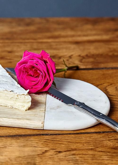 We love nothing more than a rustic but elegant platter. Serve cheese and figs in style on our wood and marble board with French knife, great for any occasion.