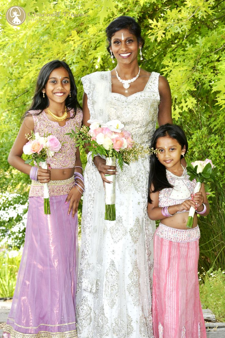 Pastel wedding flowers perfectly matching the bridal party. Charnell Timms Photography