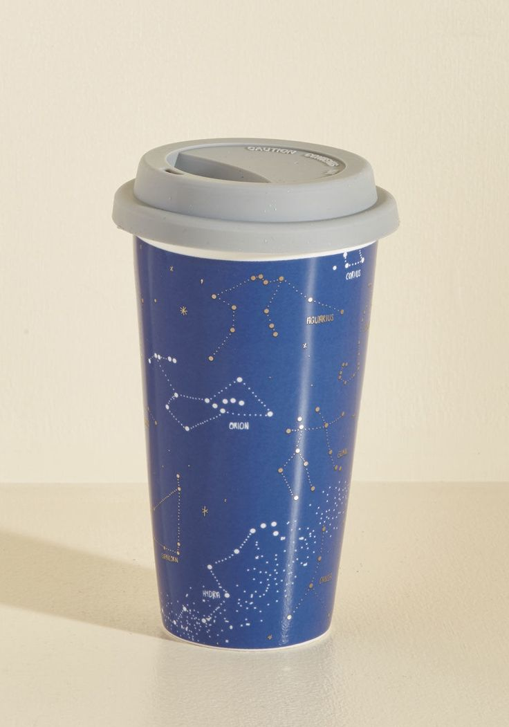 <p>When the contents of this ceramic coffee mug are enjoyed, it'll be a tasting frenzy! Decorated with metallic silver constellations and topped with a silicone lid, this navy blue travel cup turns commutes and coffee shop stops into a showcase of your cosmic style.</p>