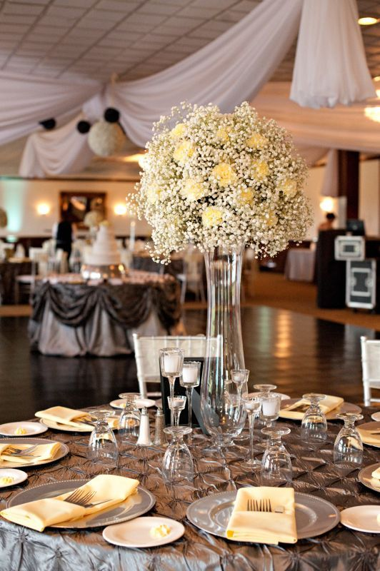 Charcoal & pale yellow, chiavari chairs, uplighting, and whole lotta lovin'. Centerpieces made of yellow carnations and baby's breath.