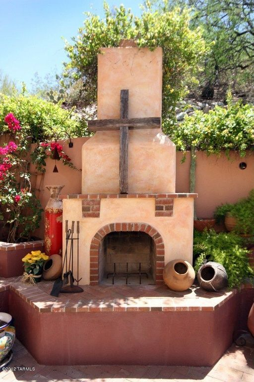 patio with exterior brick floors raised beds outdoor pizza oven