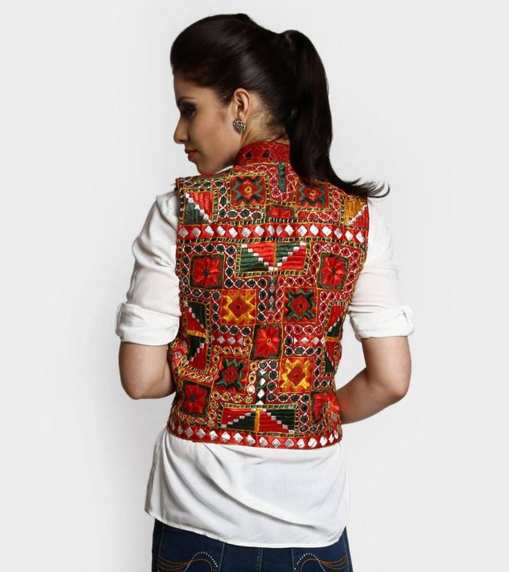 Dark color koti with work..It is great Indo-western wear..you can pair it with white shirt or white kurti! Looks trendy! It has kutchi work!