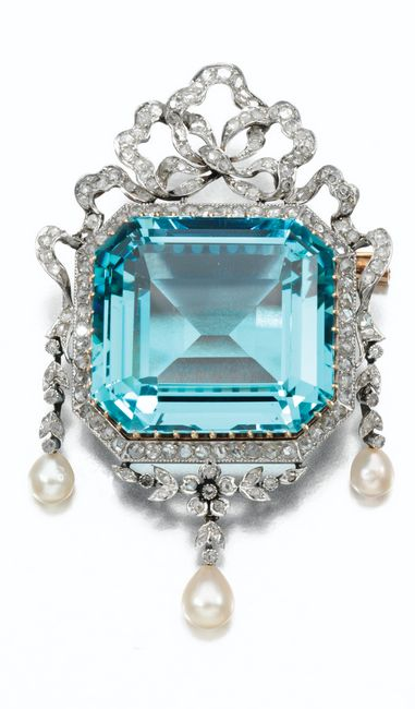 Gem set and diamond brooch, circa 1915 Of foliate and ribbon design, set with a step-cut aquamarine, seed pearl drops, and rose diamonds, French assay marks.
