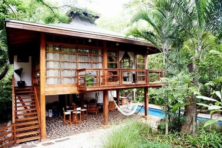 Essential Items For Your Off Grid Tiny House In 2020 Wooden House Design House On Stilts Tropical House Design
