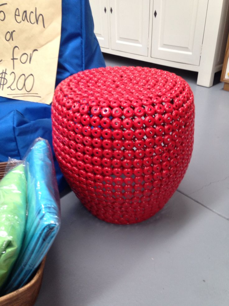 Our cap stool. Made from metal caps, this stool is very strong and comes in white, red and yellow also. Get for a side table as well.