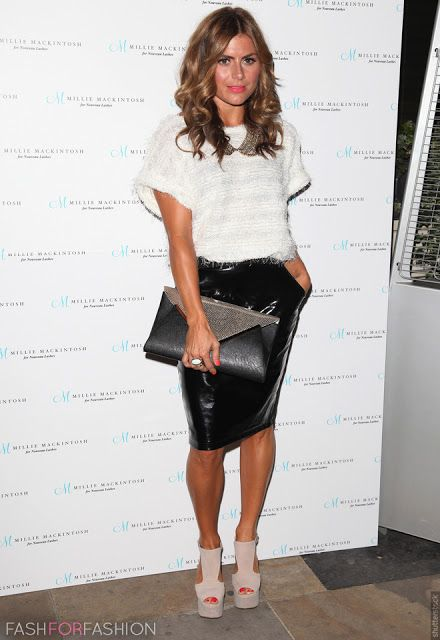 Zoe Hardman wearing knee-high leather tube skirt and white sweater combined with a collar necklace.