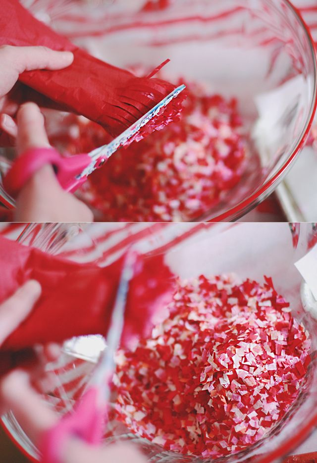 Tissue paper + Scissors = Homemade confetti. Easy. Stuff in Valentines and annoy the bajeebus out of the recipient.