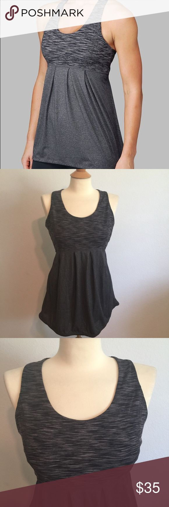 Lululemon Power Dance Gray Tank Built in Bra 12 Amazing tank by lululemon! This is the power dance Tank but is also great for running and yoga! It has a built in compression bra top and then a flowing body with drawstring bottom. This is great for yoga when doing inversions! Gently used, great condition. Size 12 lululemon athletica Tops Tank Tops