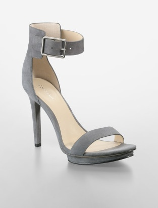 The ankle strap adds 'Wow' factor to this simple silhouette. Gorgeous. Pair with light grey cropped pants and a top in black or tangerine.  It works.