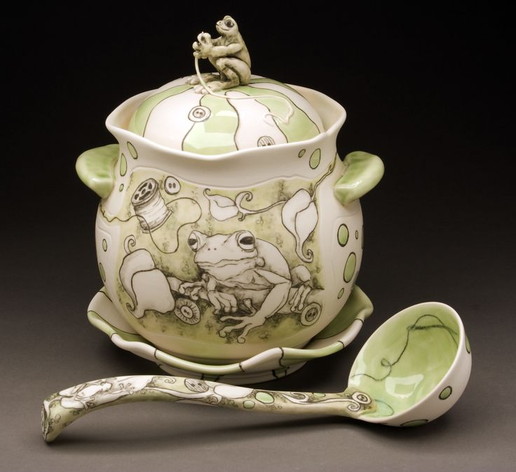 "CJ Niehaus of Springfield IL, USA. Sutura Ranam. Soup Tureen with Ladle and Saucer. The ""sewing frog"" creates the memory of the world, stitching together stories. Thrown and handbuilt porcelain with underglaze pencil and underglaze washes, glaze. Spoon - 28x9.5x8cm Tureen - h24cm 3.0kg $355/SOLD OUT"