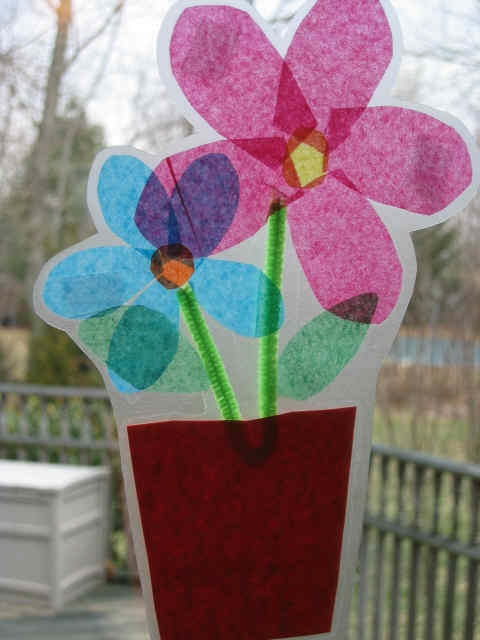 Flowerpot Window Art - kids craft. Tissue paper for the picture once made iron between two sheets grease proof paper (don't let kids help with ironing)
