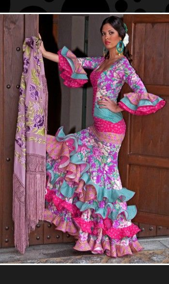 This is my favorite dress. I LOVE the turquoise and pink combo but also how some other shades are used to make it more vibrant. I'd like to put in the yellow here somewhere.