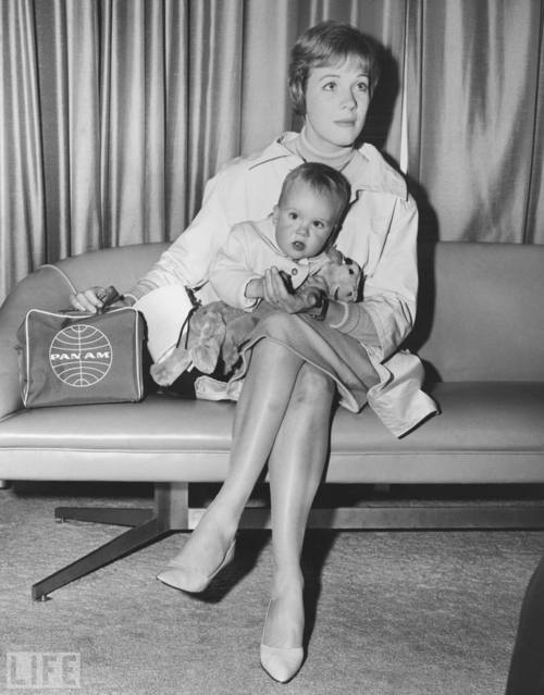 Julie Andrews holding 17 month old daughter at Kennedy Int'l Airport in April 1963. She is en route to Salzburg, Austria to film The Sound of Music.