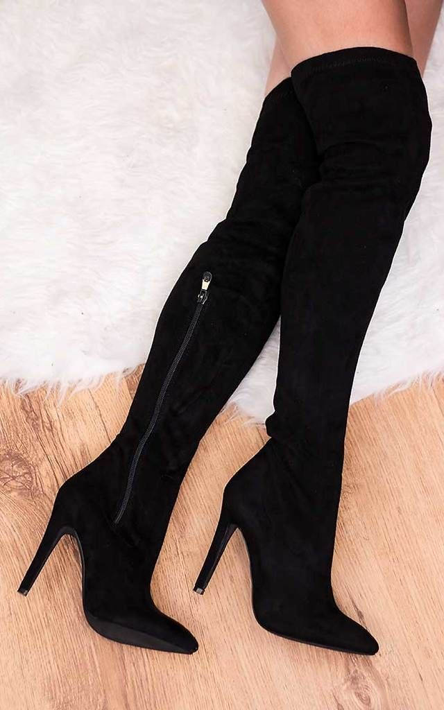 Pull yourself up to towering style heights in these over-the-knee stiletto boots. Pair with some simple black leggings and a satin roll-neck top for cutting-edge class.