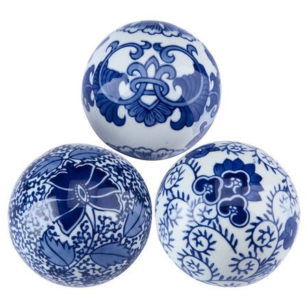 Three porcelain decorative balls in hand-painted blue and white with classic ornamentation.   Product: 3 Pieces of décor
