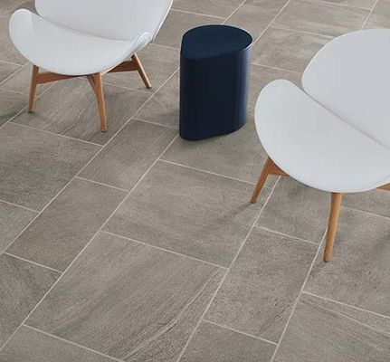 Flashbacks to chasing the surf at the shore are the desired effect of this floor. Crossville uses biomimicry to capture the striations, crushed shells, and other evidence of movement on the ocean floor in its Oceanaire Porcelain Stone collection. Waverunner (shown) is one color launched in March that adds texture to neutral floors.
