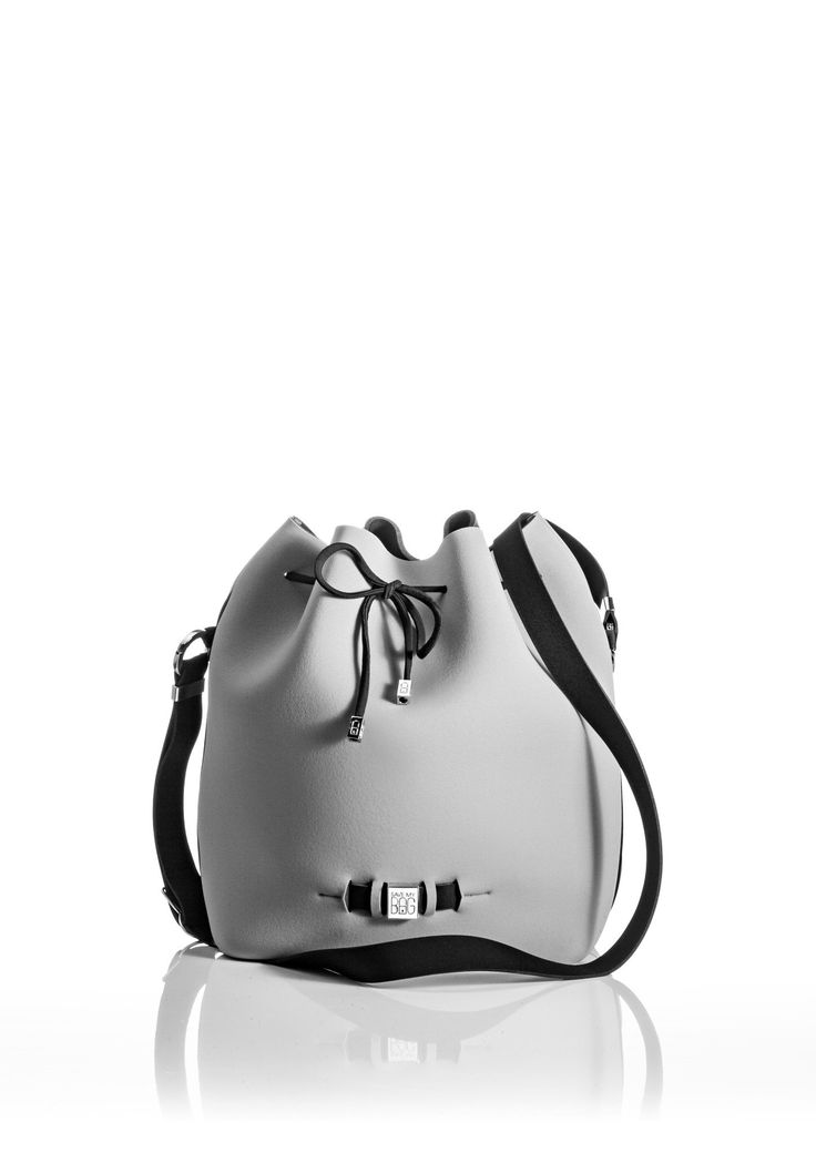 The Bubble is your bucket bag wardrobe staple.  A must-have style alongside totes and cross-bodies for the woman on the go.  With its drawstring closure, side zipper, adjustable strap and spaciousness, this is a practical day-to-day bag or one to take with you on travel adventures!   Size  240 x 175 x 30 mm  320g  Made in Italy  Vegan Friendly  Made from Poly-Lycra Fabric   Metallic Silver