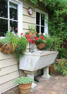 love the idea of putting an old wash-tub outside to use for planting!!