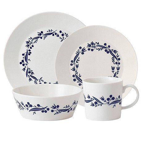 Designed by Royal Doulton and Karolin Schnoor, this 16 piece set from the 'Fable' range is made from luxury fine china and has a clean and contemporary appearance with a modern garland design. The set includes four cereal bowls, mugs, side plates and dinner plates.
