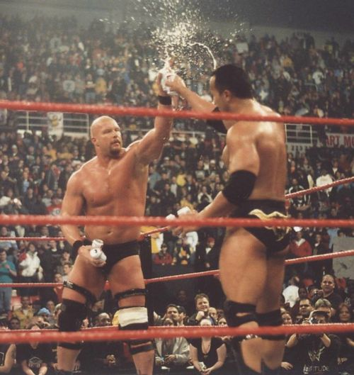 """""""Stone Cold"""" Steve Austin and The Rock drinking beers. Almost as cool as the Mega Powers shaking hands."""